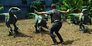 Chris Pratt with velociraptors