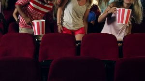 People sitting down in the cinema