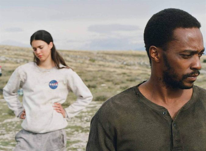 Anthony Mackie and Margaret Qualley in Io